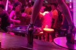 private investigators thailand, photographing a Thai bar girl